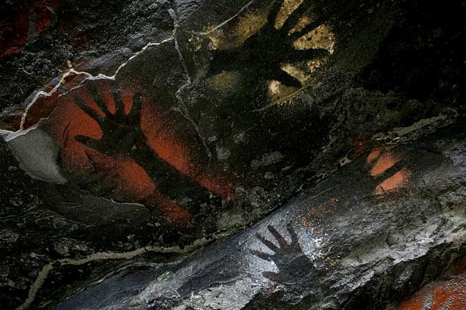 04-cave-wall-handprints-670